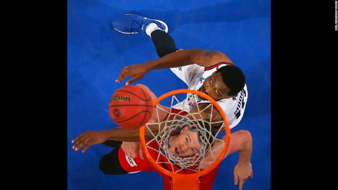 Perth's Lucas Walker, bottom, tries to box out Adelaide's Ramone Moore during a basketball game in Perth, Australia, on Friday, December 8.