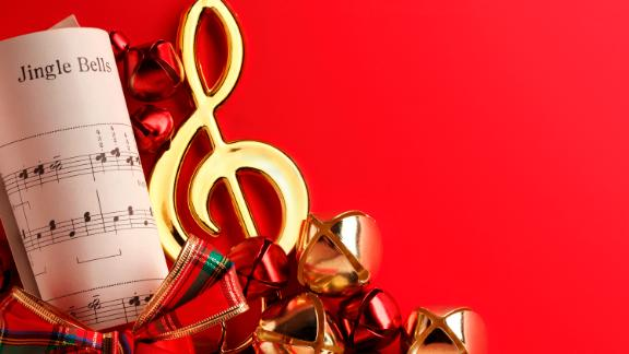 Several Christmas bells and red ribbon on the sheet music from the Christmas classic  Jingle Bells.To see more holiday images click on the link below: