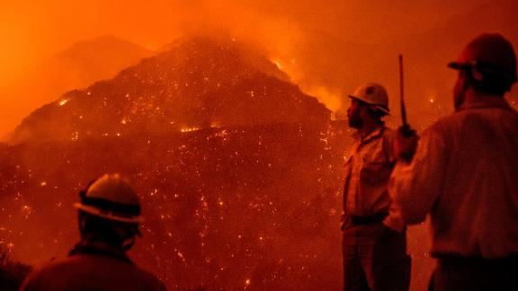 Firefighters monitor the Thomas fire as it burns through Los Padres National Forest.