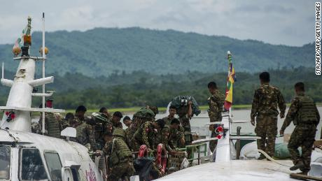 Myanmar soldiers arrive at Buthidaung jetty in Myanmar's Rakhine State on August 29, 2017. Rohingya Muslims are once more fleeing in droves towards Bangladesh, trying to escape the latest surge in violence in Rakhine state between a shadowy militant group and Myanmar's military. / AFP PHOTO / STR        (Photo credit should read STR/AFP/Getty Images)