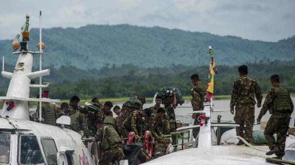 Myanmar soldiers arrive at Buthidaung jetty in Myanmar