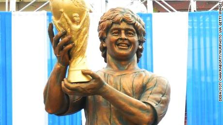 Argentine footballer Diego Maradona remote control inaguration his bronze Statute at North Kolkata sribhumi Sporting club visit in the Indian city of Kolkata on December 11, 2017. Maradona is on a private visit to India.  (Photo by Debajyoti Chakraborty/NurPhoto via Getty Images)