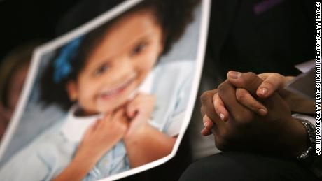 NEWTOWN, CT - JANUARY 14:  Nelba Marquez Greene and her husband Jimmy Green whose daughter Ana Grace Marquez Green (age 6 in photo), was killed in the Sandy Hook massacre, hold hands during a press conference on the one month anniversary of the Newtown elementary school massacre on January 14, 2013 in Newtown, Connecticut. Eleven families of Sandy Hook massacre victims came to the event one month after the shooting to give their support to Sandy Hook Promise, a new non-profit with the goal of preventing such tragedies in the future.  (Photo by John Moore/Getty Images)