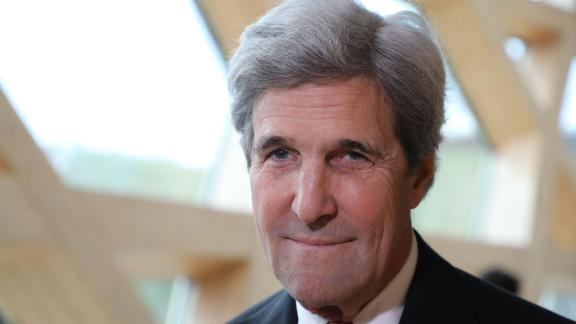 Former US secretary of state John Kerry smiles during the One Planet Summit on December 12, 2017 at La Seine Musicale venue on l'ile Seguin in Boulogne-Billancourt, west of Paris.  AFP PHOTO / LUDOVIC MARIN