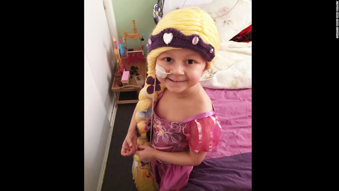 Five-year-old Sophie is battling acute lymphoblastic leukemia. She received a long Rapunzel wig from the Magic Yarn Project and loves wearing it with her Rapunzel dress.