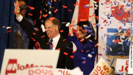 BIRMINGHAM, AL - DECEMBER 12:  Democratic U.S. Senator elect Doug Jones (L) and wife Louise Jones (R) greet supporters during his election night gathering the Sheraton Hotel on December 12, 2017 in Birmingham, Alabama.  Doug Jones defeated his republican challenger Roy Moore to claim Alabama's U.S. Senate seat that was vacated by attorney general Jeff Sessions. (Photo by Justin Sullivan/Getty Images)