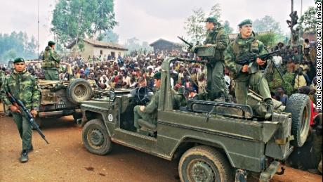 Hutus welcoming a French marines detachment as they drive through a refugee camp, some 4kms outside Butare, in July 1994. The Rwandan government is investigating France's involvement in the genocide that killed 800,000 people.