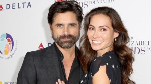 BEVERLY HILLS, CA - OCTOBER 24:  (EDITORIAL USE ONLY. NO COMMERCIAL USE)  John Stamos (L) and Caitlin McHugh attend The Elizabeth Taylor AIDS Foundation and mothers2mothers dinner at Ron Burkle