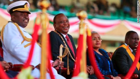 Kenya's President Uhuru Kenyatta, center, suffered through a difficult 2017.
