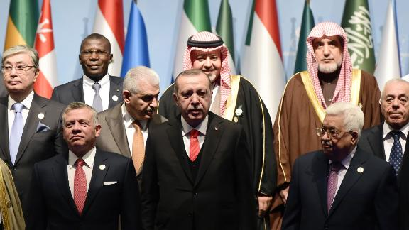 Turkish President Erdogan (front row, C) and Palestinian Authority President Abbas (front row, R) with other leaders at the OIC summit