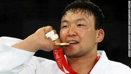 BEIJING - AUGUST 14:  Gold medalist Tuvshinbayar Naidan of Mongolia poses on the podium during the medal ceremony for the Men's 100 kg judo competition at the University of Science and Technology Gymnasium during Day 6 of the Beijing 2008 Olympic Games on August 14, 2008 in Beijing, China.  (Photo by Quinn Rooney/Getty Images)