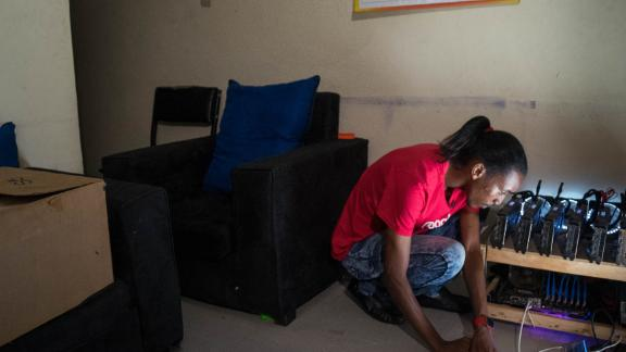 Eugene Mutai in his front room with his self-built cryptocurrency mining machine. Mutai is part of a growing tech scene on the continent.   Meet the innovators and inventions driving Africa