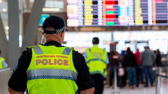 Police guard the passenger security check area at Sydney Airport on July 30.