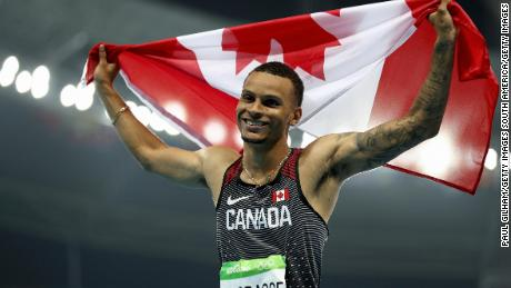RIO DE JANEIRO, BRAZIL - AUGUST 14:  Andre De Grasse of Canada celebrates after the Men's 100 meter final on Day 9 of the Rio 2016 Olympic Games at the Olympic Stadium on August 14, 2016 in Rio de Janeiro, Brazil.  (Photo by Paul Gilham/Getty Images)