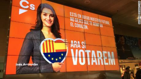 An electronic campaign poster of Inés Arrimadas, lead candidate for the anti-independence  Ciutadans party, at the Barcelona Sants train station.
