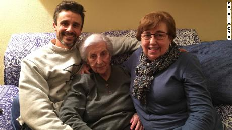 Rosario Caceres, 95, center, with her grandson, David Rosello, left, and her daughter, Maria Victoria Cutrona.