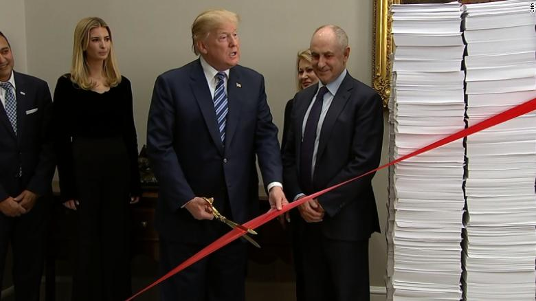 Trump cuts ribbon on regulation reduction