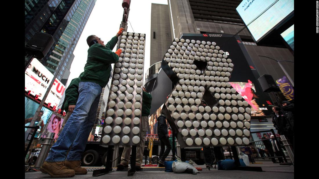 Workers prepare a display Wednesday, December 13, for the New Year's Eve celebration in New York's Times Square.