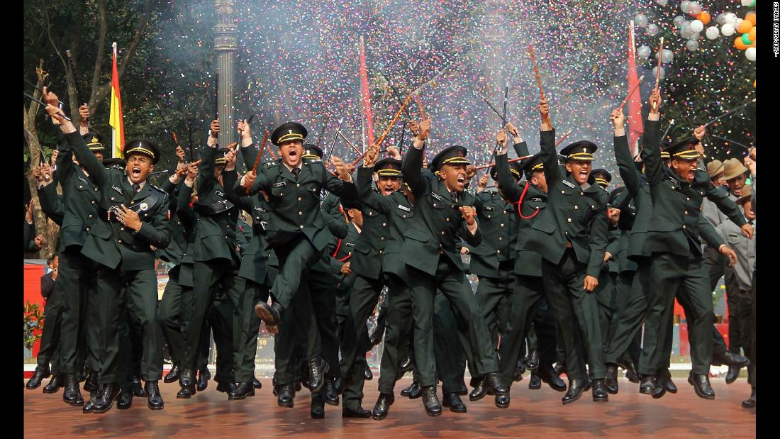 Army cadets celebrate after their graduation ceremony in Gaya, India, on Saturday, December 9.