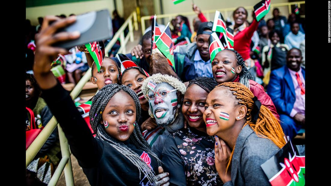 People take a selfie together during Independence Day celebrations in Nairobi, Kenya, on Tuesday, December 12.