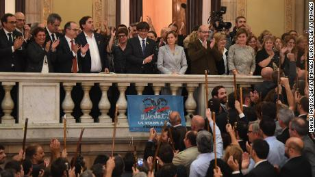 Carles Puigdemont, center on balcomy, addresses Catalan mayors after parliament voted in favor of independence on October 27, 2017.