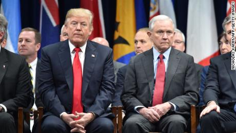 President Donald Trump sits with Attorney General Jeff Sessions on December 15, 2017 in Quantico, Virginia, before participating in the FBI National Academy graduation ceremony.