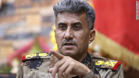 Lt. General Abdul-Wahab al-Saadi, center, commander for the Iraqi counterterrorism forces' operation to re-take Fallujah from Islamic State militants, speaks during an interview with The Associated Press at a military camp outside Fallujah, Iraq, Monday, June 27, 2016.  Al-Saadi who led the operation to retake the city, said that IS militants torched hundreds of houses in Fallujah's north and west as they fled Sunday, just as the fighters did in many of the city's other neighborhoods over the course of the operation. (AP Photo/Hadi Mizban)