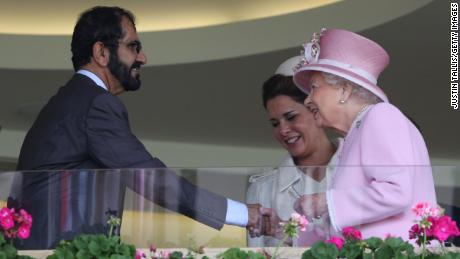 Britain's Queen Elizabeth greets Sheikh Mohammed and his wife in Ascot's Royal Box.