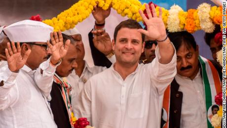 Rahul Gandhi waves during an election campaign rally on December 9, 2017 in Ahmedabad.