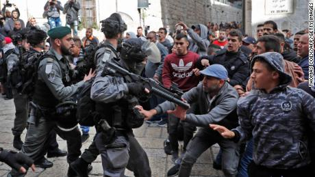 Israeli forces confront Palestinian protesters in Jerusalem's Old City.