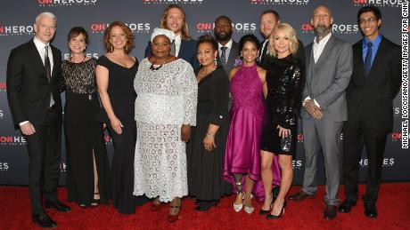 NEW YORK, NY - DECEMBER 17: (L-R) Anderson Cooper, Leslie Morissette, Amy Wright, Rosie Mashale, Andrew Manzi, Mona Patel, Khali Sweeney, Mona Patel, Kelly Ripa, Aaron Valencia, and Samir Lakhani attend CNN Heroes 2017 at the American Museum of Natural History on December 17, 2017 in New York City. 27437_017  (Photo by Michael Loccisano/Getty Images for CNN)