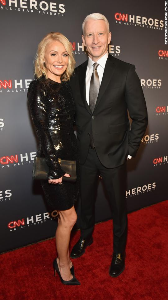 "Hosts Kelly Ripa and Anderson Cooper arrive at the 2017 ""CNN Heroes All-Star Tribute"" at the American Museum of Natural History on Sunday, December 17, in New York City."