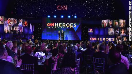 NEW YORK, NY - DECEMBER 17:  Kelly Ripa and Anderson Cooper speak onstage during CNN Heroes 2017 at the American Museum of Natural History on December 17, 2017 in New York City. 27437_015  (Photo by Kevin Mazur/Getty Images for CNN)