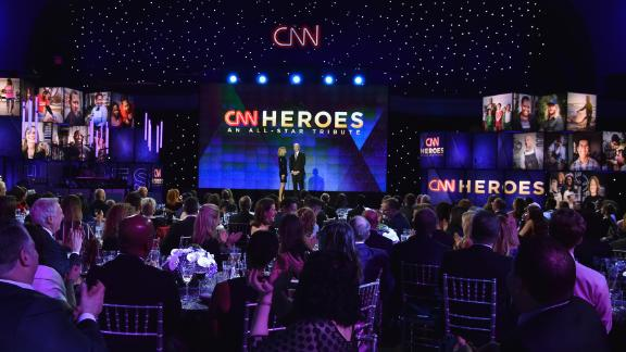 Co-hosts Kelly Ripa and Anderson Cooper speak onstage during 2017's CNN Heroes tribute gala, held on December 17 at the American Museum of Natural History in New York City.