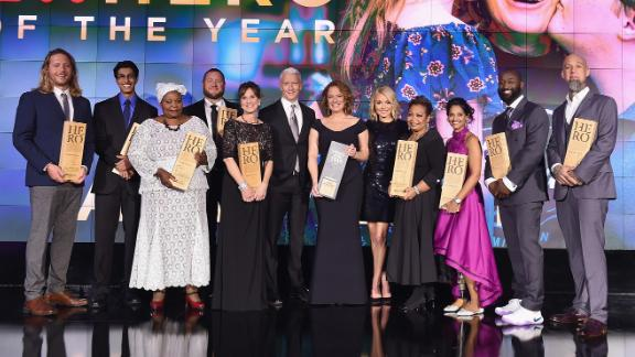 Anderson Cooper and Kelly Ripa with the 2017 Top 10 CNN Heroes, from left to right: Andrew Manzi, Samir Lakhani, Rosie Mashale, Stan Hays, Leslie Morissette, Anderson Cooper, Amy Wright, Kelly Ripa, Jennifer Maddox, Mona Patel, Khali Sweeney, and Aaron Valencia.