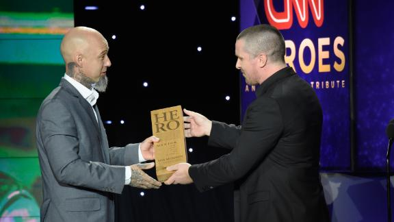 2017 CNN Hero Aaron Valencia, left, accepts his award from actor Christian Bale.