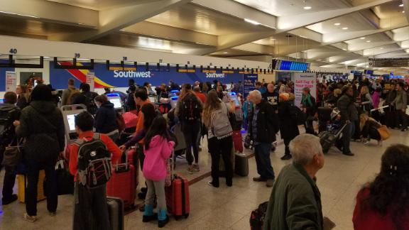 Passengers wait to learn if their flights will leave Atlanta on Monday.