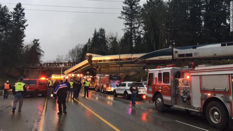 An Amtrak train car derailed and is dangling on to Interstate 5 in Pierce County, Washington, according to the Washington State Department of Transportation's twitter. All southbound lanes of the I-5 are closed due to the derailment.