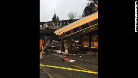 Some of the Amtrak rail cars that derailed Monday in Washington State.