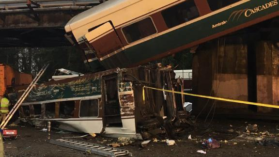 An Amtrak train car dangled onto Interstate 5 in Pierce County, Washington, after it derailed in December.