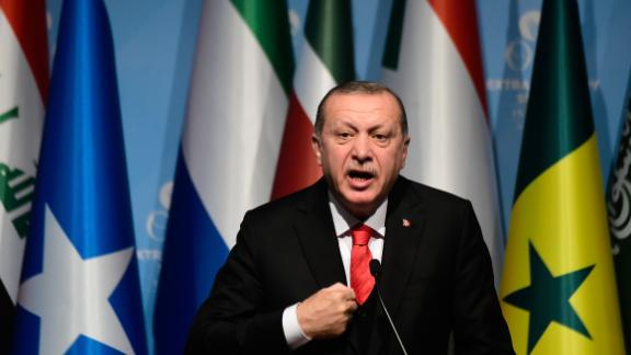 Turkish President Recep Tayyip Erdogan speaks as he holds a press conference following the Extraordinary Summit of the Organisation of Islamic Cooperation (OIC) on last week's US recognition of Jerusalem as Israel's capital, on December 13, 2017, in Istanbul. Islamic leaders on December 13 urged the world to recognise occupied East Jerusalem as the capital of Palestine, as Palestinian president Mahmoud Abbas warned the United States no longer had any role to play in the peace process. / AFP PHOTO / YASIN AKGUL        (Photo credit should read YASIN AKGUL/AFP/Getty Images)