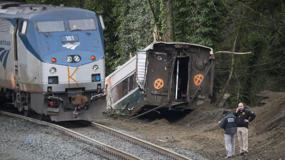 Law enforcement officials work at the scene of the derailment on December 18. The train was making the first trip of a new route that goes from Seattle to Portland, Oregon.