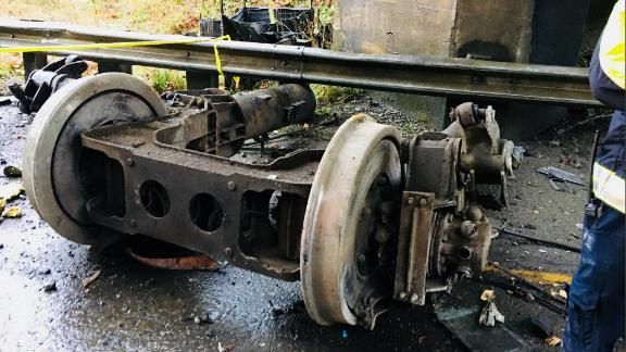Some of the train's wreckage is seen at the crash site on December 18.