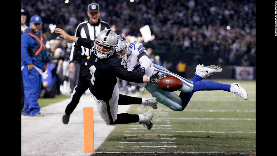 Oakland quarterback Derek Carr reaches for the goal line but fumbles out of the end zone during an NFL game against Dallas on Sunday, December 17. The late-game touchback ended the Raiders' hopes of winning the game.