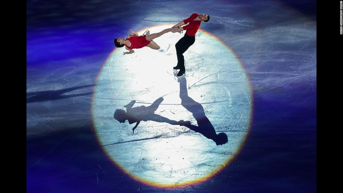 Canadian figure skaters Meagan Duhamel and Eric Radford perform in Beijing during the Stars on Ice Tour on Saturday, December 16.