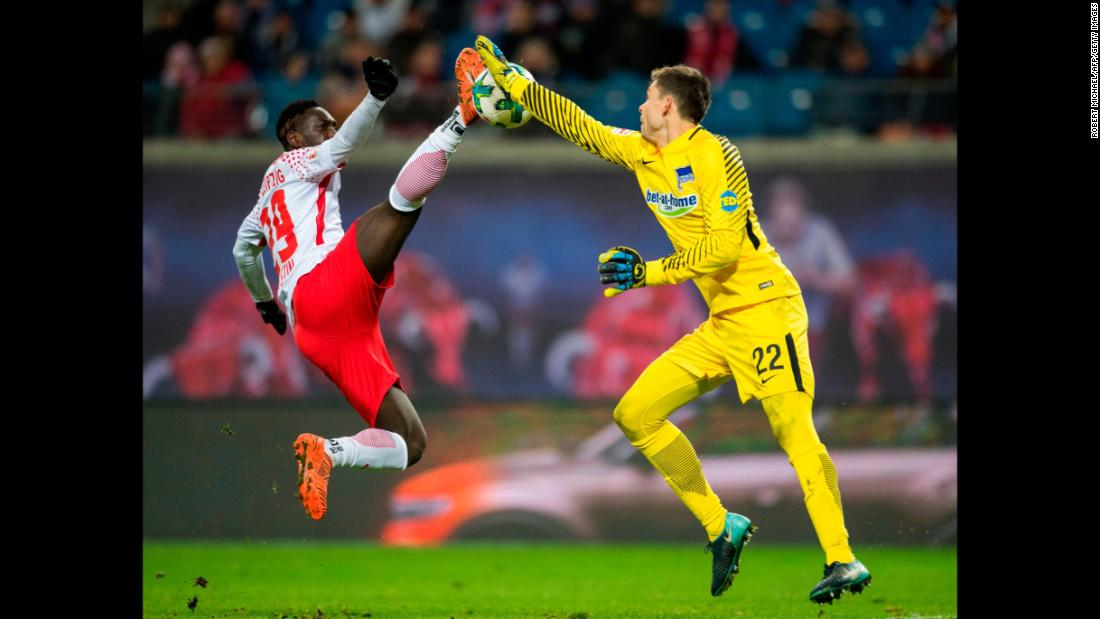 RB Leipzig forward Jean-Kevin Augustin and Hertha Berlin goalkeeper Rune Jarstein compete for the ball during a German league soccer match on Sunday, December 17.