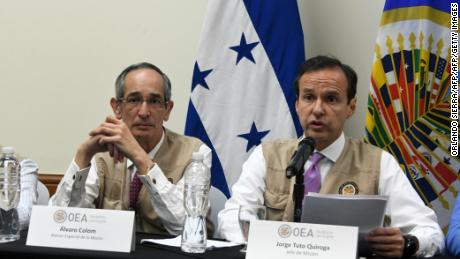 OAS representatives Alvaro Colom, left, and Jorge Tuto Quiroga at a press conference in Tegucigalpa, Honduras.