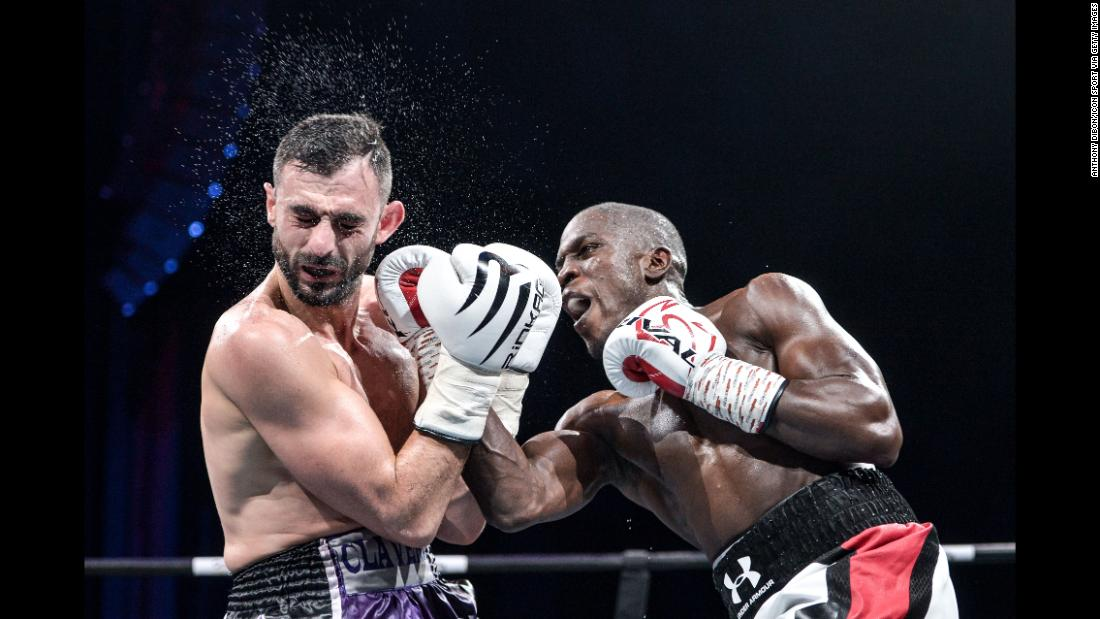 Souleymane Cissokho punches Manuel Clavero during a bout in Boulogne-Billancourt, France, on Saturday, December 16. Cissokho won in the seventh round.