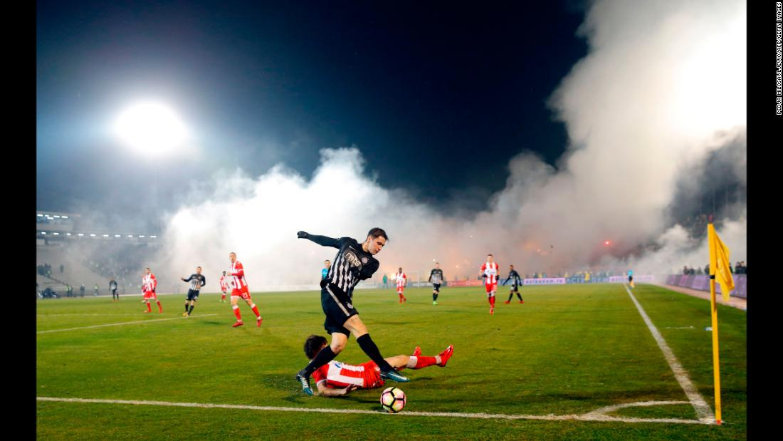 Smoke rises from the stands during a Serbian league match between rivals Partizan Belgrade and Red Star Belgrade on Wednesday, December 13.
