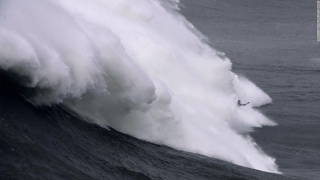 A surfer rides a massive wave in Nazare, Portugal, on Friday, December 15.
